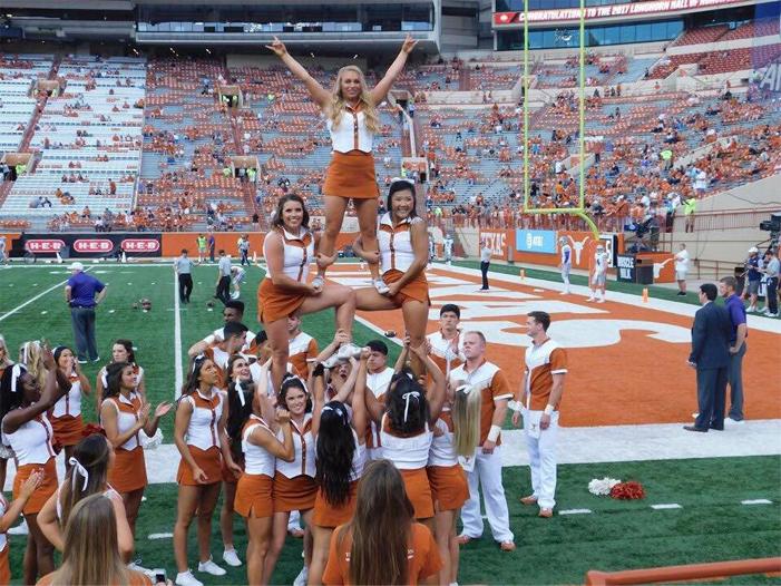 Abby L UT Cheer 3 level stunt